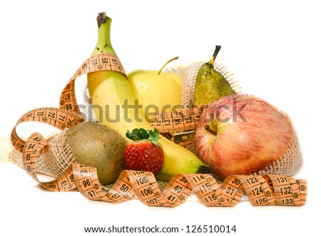 Composition of mixed fruit with a meter that revolves around the concept of balanced diet