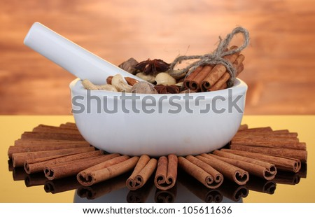 Composition of mortar with nuts and cinnamon on wooden