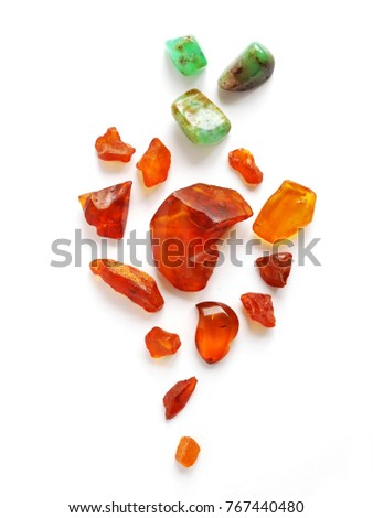 Composition of natural stones of amber and chrysoprase. Amber stone isolated on white background. Natural raw amber. Jewelery from amber. #767440480
