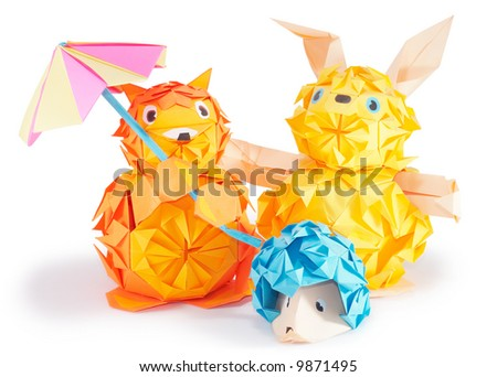 Composition of origami figures (hare, hedgehog, fox) isolated on white (with shadows and clip path)