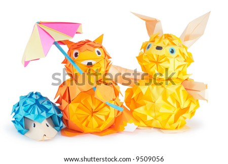 Composition of origami figures (hare, hedgehog, fox) isolated on white (with shadows and clipping path)