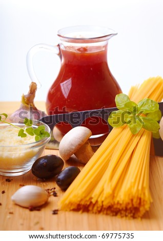 Composition of pasta, tomato, cheese, olive and garlic