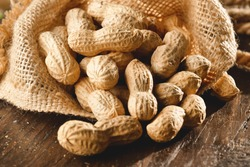Composition of peanuts serving to make oil, peanut butter. Great for healthy and dietary nutrition. Concept of: condiments, dried fruit, food.