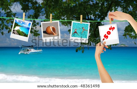 Composition of photos hanging on rope over travel background as a discount idea (copy-paste material)