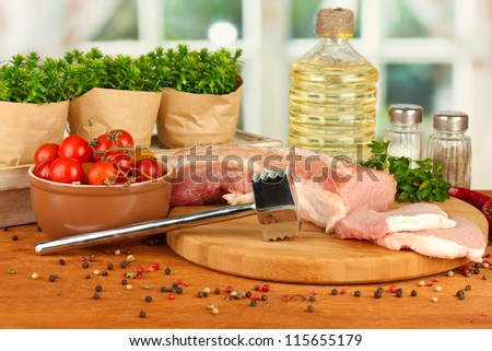 composition of raw meat, vegetables and spices on wooden table close-up