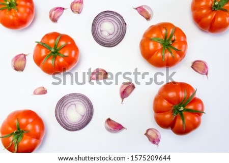 Composition of salad tomatoes, onion and garlic on white background Zdjęcia stock ©