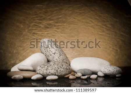 Composition of stones on a gold background