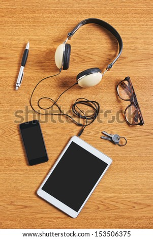 Composition Of Tablet, Phone And Headphones On A Desk. Different Business Objects.
