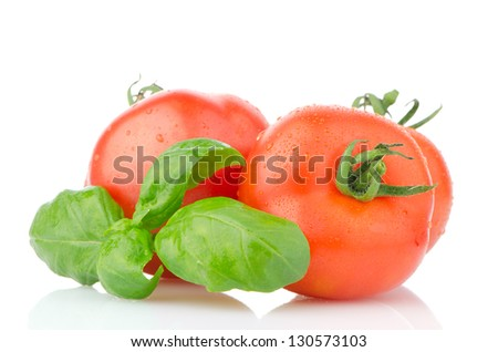Composition of: tomato and basil leaves Isolated on white background.
