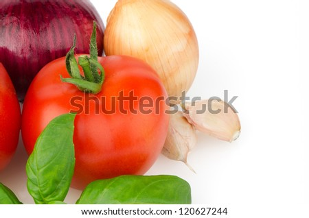 Composition of: tomato, tagliatelli, garlic and  basil Isolated on white background.