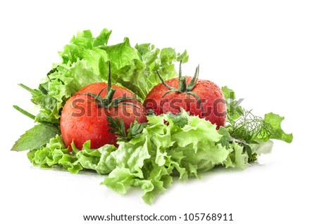 Composition of tomatoes and lettuce with flying water droplets isolated on white background