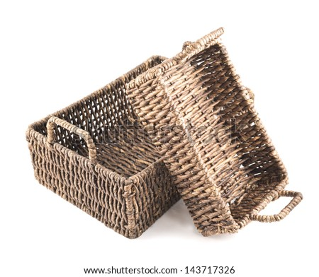 Composition of two brown wicker baskets, box shaped, isolated over white background
