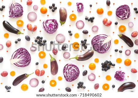Composition of vegetables and fruits on a white background. Pattern made from fresh vegetables and fruits. Top view, flat design. Collage of red cabbage in a cut, eggplants, plums, grapes, mandarins. #718490602