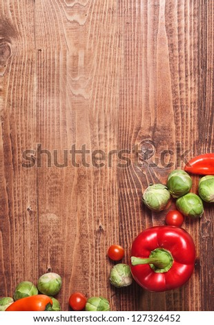 Composition of veggies on wooden table surface