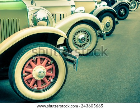 Composition of vintage car wheels - Concept of retro classic vehicles transportation