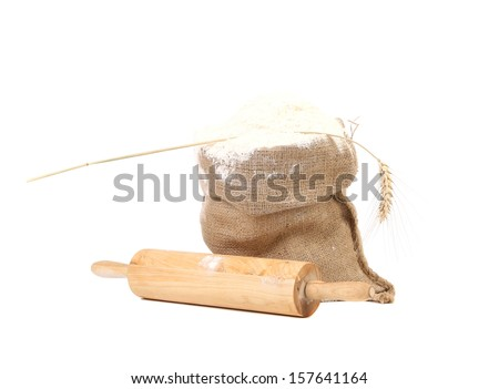Composition of wheat flour in sack. Isolated on a white background.