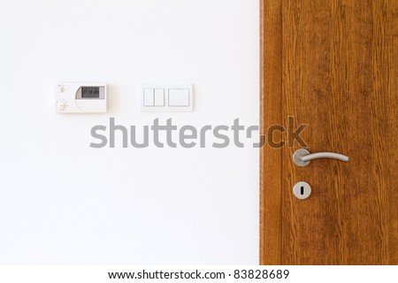 Composition of wooden door and white wall
