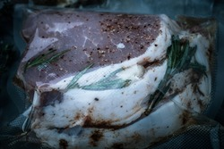 Composition with a meat prepared for cooking on a textured plastered surface. Toned.