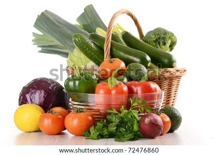 Composition with a variety of raw vegetables in wicker basket isolated on white