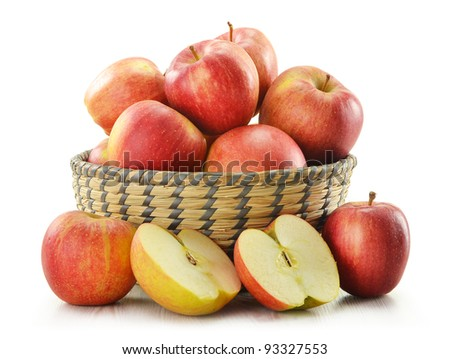 Composition with apples in basket isolated on white
