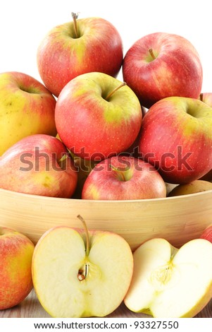 Composition with apples in wooden dish isolated on white