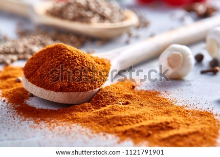 Composition with aromatic peppercorn in the wooden spoons on the white background, flat lay, close-up, selective focus. #1121791901