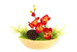 Composition with artificial flowers in a pot isolated on white background