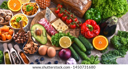 Composition with assorted food products on kitchen table. #1450731680