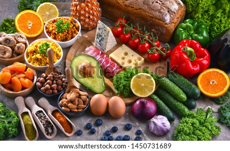 Composition with assorted food products on kitchen table. #1450731689