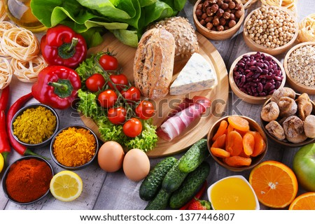 Composition with assorted organic food products on wooden kitchen table. Imagine de stoc ©