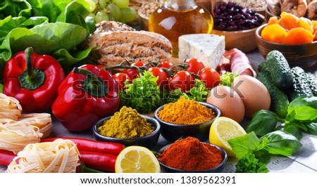 Composition with assorted organic food products on wooden kitchen table. #1389562391