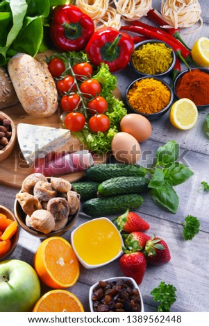 Composition with assorted organic food products on wooden kitchen table. #1389562448