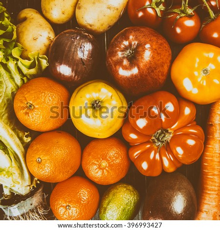 Composition with assorted raw organic vegetables on black wooden background #396993427