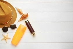 Composition with beach accessories on white wooden background