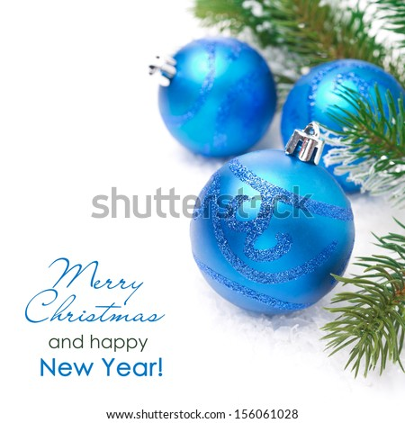composition with blue Christmas balls and spruce branches, isolated on white