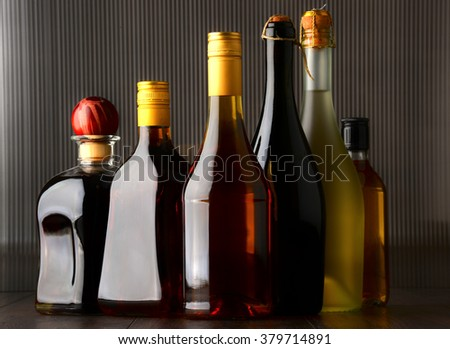 Composition with bottles of assorted alcoholic beverages. #379714891