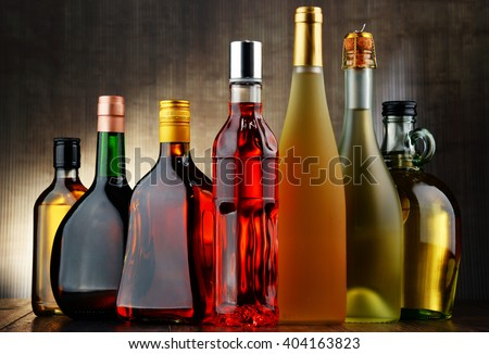 Composition with bottles of assorted alcoholic beverages. #404163823