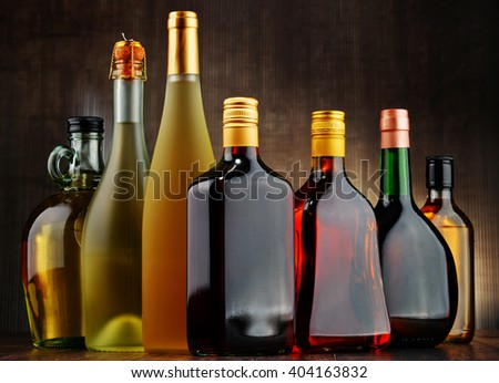 Composition with bottles of assorted alcoholic beverages. #404163832