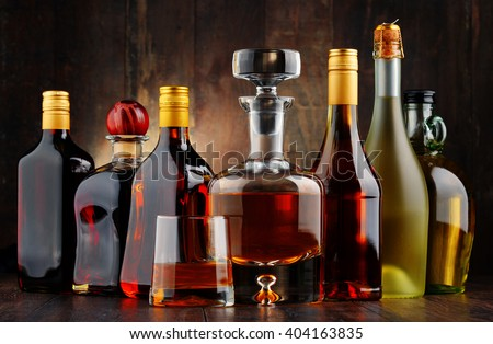 Composition with bottles of assorted alcoholic beverages. #404163835