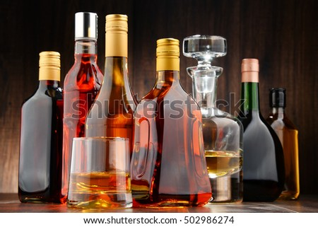 Composition with bottles of assorted alcoholic beverages. #502986274