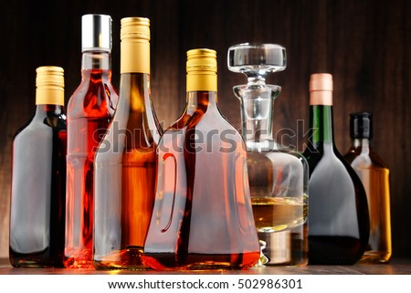 Composition with bottles of assorted alcoholic beverages. #502986301