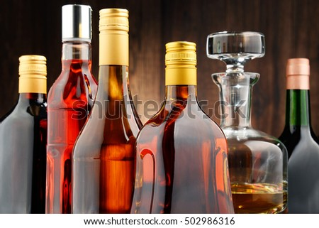 Composition with bottles of assorted alcoholic beverages. #502986316