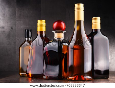 Composition with bottles of assorted alcoholic beverages. #703853347