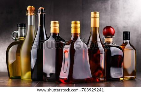 Composition with bottles of assorted alcoholic beverages. #703929241
