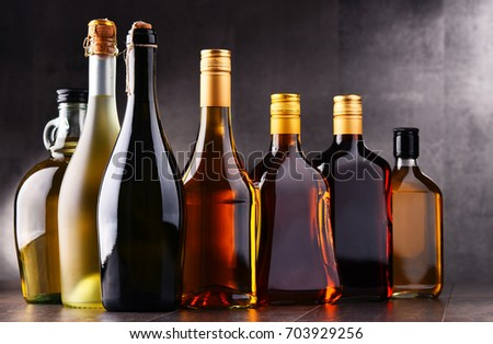 Composition with bottles of assorted alcoholic beverages. #703929256