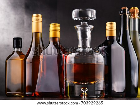 Composition with bottles of assorted alcoholic beverages. #703929265