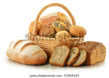 Composition with bread and rolls in wicker basket isolated on white #91804181