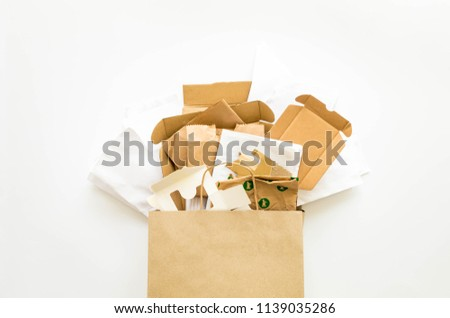 Composition with brown and white eco paper, from used boxes, packages, bags, prepared for recycling. Reduce, Reuse and Recycle concept. Flat lay, view from above