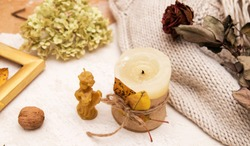 Composition with candles with fallen leaves, dry rose, sweater. Autumn concept