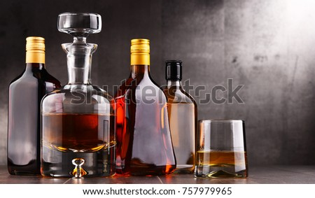 Composition with carafe and bottles of assorted alcoholic beverages. #757979965